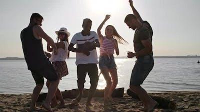 Friends Dancing on Beach