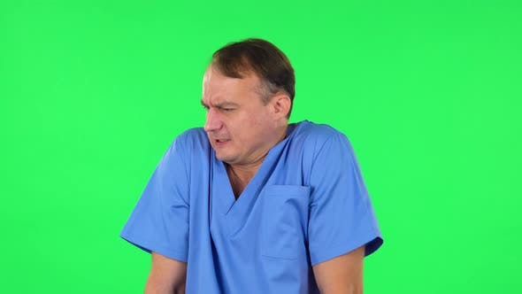 Medical Man Froze and Trying To Keep Warm Against Green Screen.