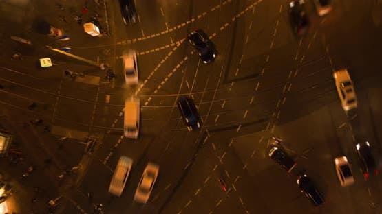 AERIAL: Beautiful Aerial Drone Time Lapse of Busy Intersection at Night in Berlin, Germany with City