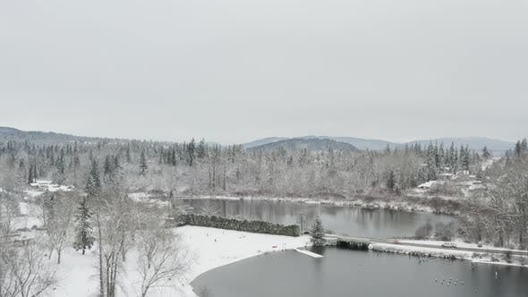Thumbnail for Snow Covered City Of Bellingham Washington Lake Whatcom Aerial Reveal Of Downtown Overview