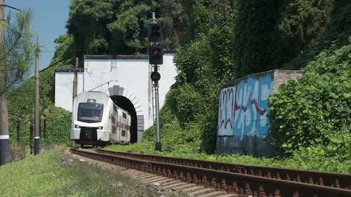 Batumi, Georgia - May 23 2021: Georgian railway high speed train moving over the camera