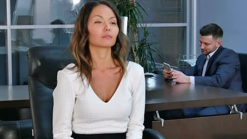 Young Healty Office Woman Doing Fitness Exercise at Workplace While Sitting in Office Chair