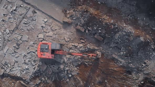 Air View. Demolition Work Is Carried Out with the Help of an Excavator. Heavy Machinery