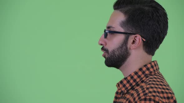 Thumbnail for Closeup Profile View of Happy Young Bearded Persian Hipster Man Talking