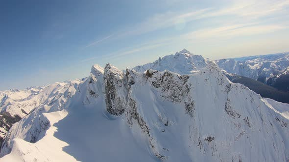 Thumbnail for Epic Aerial Footage Flying Near Snow Covered Jagged Mountain Ridge Spiky Peaks Whatcom County