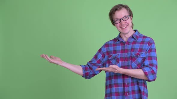 Thumbnail for Happy Young Handsome Hipster Man Showing Something