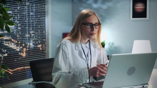 Female Mental Health Professional Providing Online Therapy Session with Patient By Computer