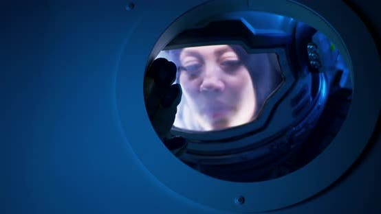 Thumbnail for Female Astronaut Looking Out of Spaceship Porthole