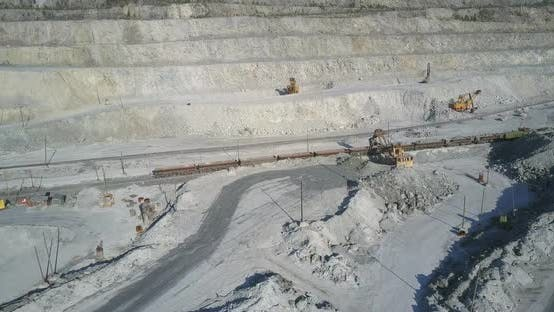 Thumbnail for Aerial View Excavator Loads Freight Train Wagons with Rock