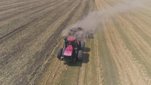 Thumbnail for Aerial view of tractor plowing a field