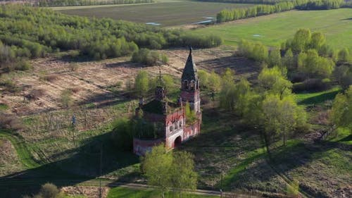 Flying around old ruined Russian church in a village.