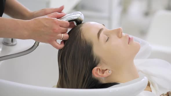 Thumbnail for Beauty Concept, Young Woman with Hairdresser Washing Head at Hair Salon