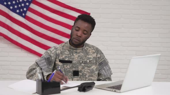 American Soldier Working on Laptop in Headquarters Building