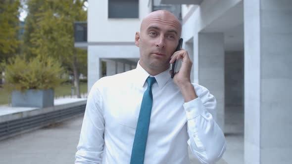 Thumbnail for Confident Businessman Wearing White Shirt