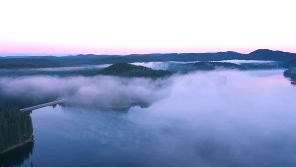 Thumbnail for Fly over the morning fog over the mountain lake. Rodopi mountain Bulgaria