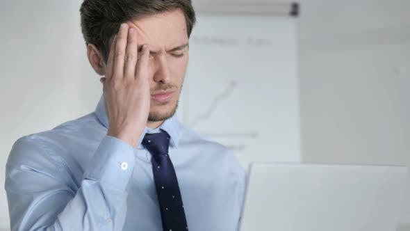 Thumbnail for Close Up of Young Businessman with Headache Working in Office