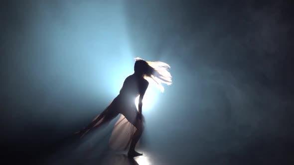 Thumbnail for Female Dancing Contemp in Dark Studio Against Spotlight. Slow Motion