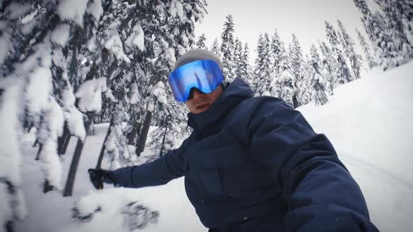 Thumbnail for Man Backcountry Snowboarding With Handheld Camera