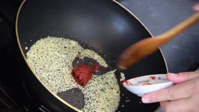 Cooking Macro Slow motion of jasmine rice that is cooked and then served on a plate.