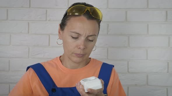 Woman Electrician with a Screwdriver