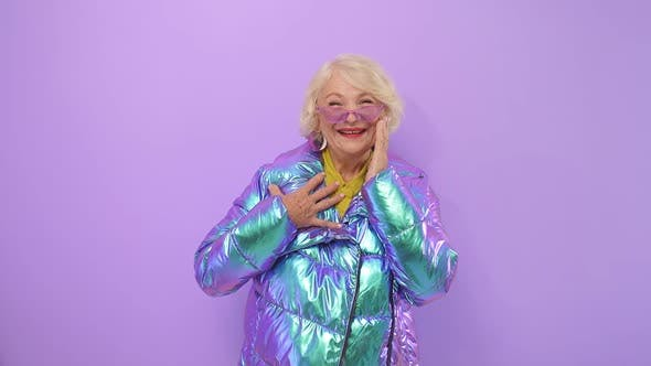 Attractive Stylish Granny, a Caucasian Woman of Retirement Age Fashionably Dressed Posing Directly