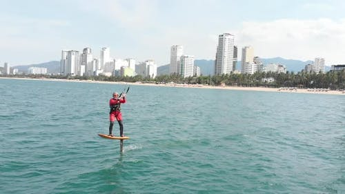 Professional Kite Surfer on the Sea Wave, Athlete Showing Sport Trick Jumping with Kite and Board in