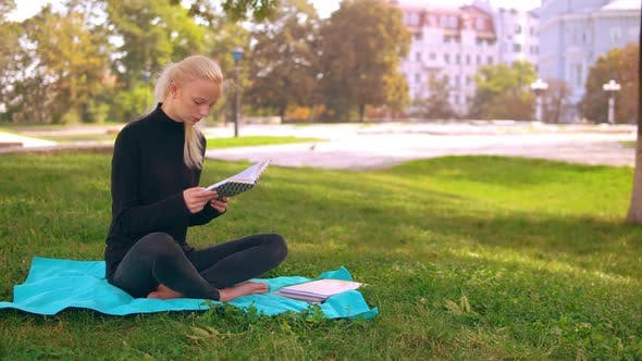Thumbnail for Girl Blonde Studying Outdoors