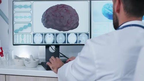 Handheld Shot of Doctor in Front of 3D Brain Scan