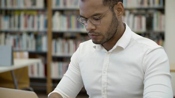 Thumbnail for Thoughtful African American Student Studying at Library