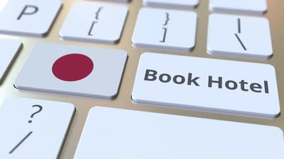 BOOK HOTEL Text and Flag of Japan on the Keyboard