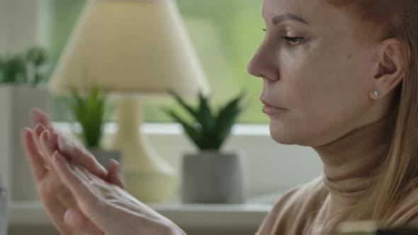 Thumbnail for Gorgeous Blond Caucasian Woman Applying Hand Cream