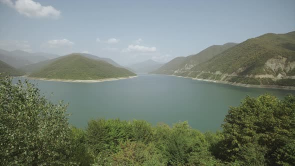 Thumbnail for A Large Mountain Lake with Turquoise or Blue Water, Green Mountains and Hills