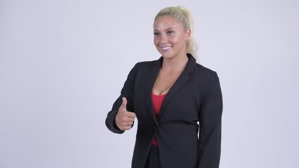 Thumbnail for Young Happy Blonde Businesswoman Giving Thumbs Up
