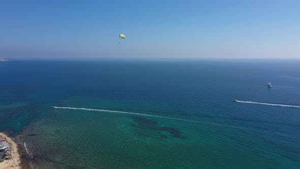 Aerial: Parasailing in the resort town of Ayia Napa, Cyprus