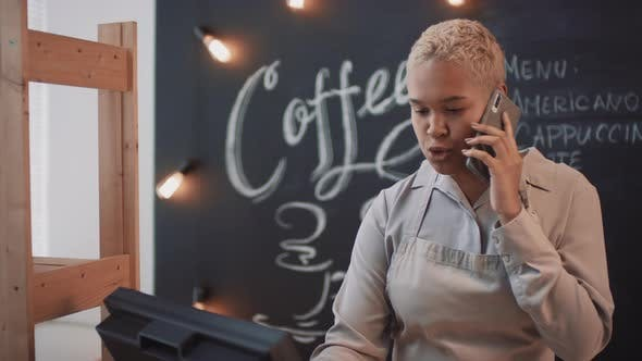 Thumbnail for African American Waitress Having Phone Call