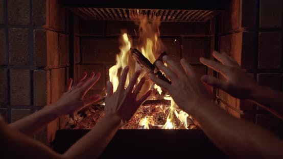 Thumbnail for Couple Hands Warms His Hands By the Fire Burning Fireplace. Closeup of Hands.