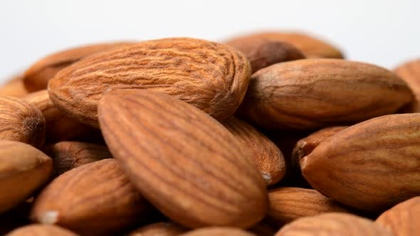 Thumbnail for Almonds rotating close-up on white background