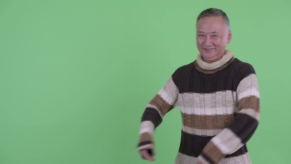 Thumbnail for Happy Mature Japanese Man Showing Something
