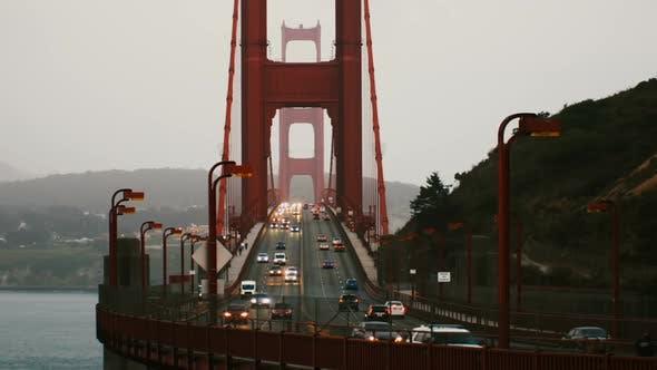 Thumbnail for Medium Time Lapse Shot of Car Traffic Lights on Iconic Golden Gate Bridge in Summer Sunset San