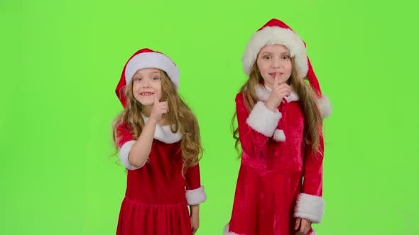 Thumbnail for Baby of the Assistant Santa Claus Say Quietly To Their Elves, Green Screen