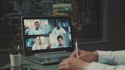 Computer Monitor with Video Conference of Multiracial Doctors' Leaders