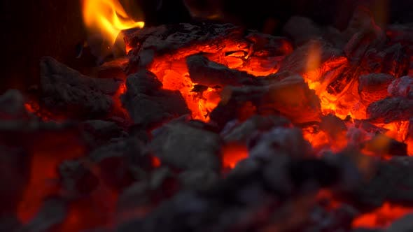 Close Up View of Burning Coals with Fire, Glowing Charcoal Background