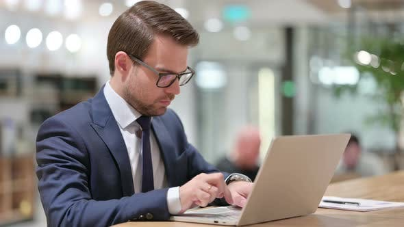 Thumbnail for Businessman with Laptop Showing No Gesture, Disapprove