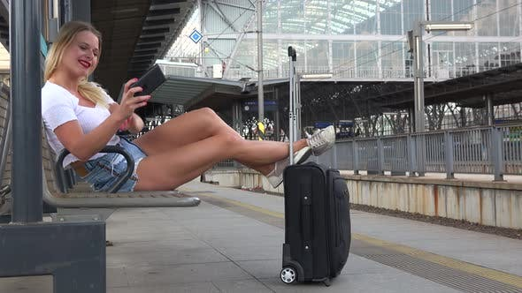 Thumbnail for A Young Beautiful Woman Takes Selfies on a Train Station Platform