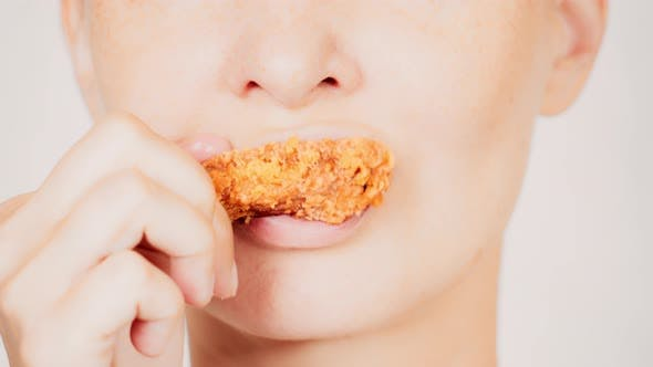 Thumbnail for Portrait Female Eats Fried Meat