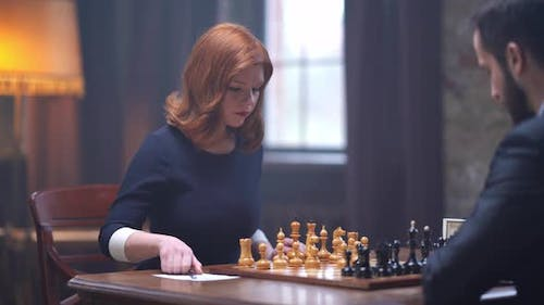 Lady Play Chess With Man