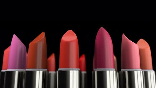 Colorful Lipsticks with Red Tint on the Makeup Fashion Cosmetic Presentation 4k