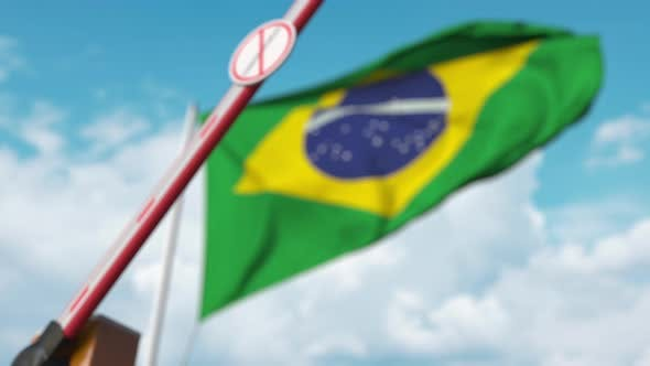 Thumbnail for Closed Gate with STOP CORONAVIRUS Sign on the Brazilian Flag Background
