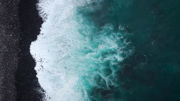 Cover Image for Top View of a Deserted Black Volcanic Beach. Coast of the Island of Tenerife. Aerial Drone Footage