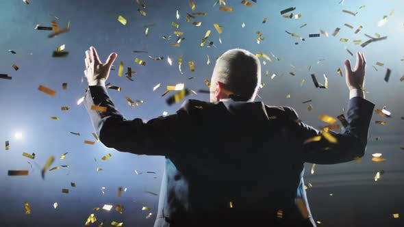 Thumbnail for Successful Businessman with Arms Up Celebrating His Victory. Celebrating Success. Low Angle View